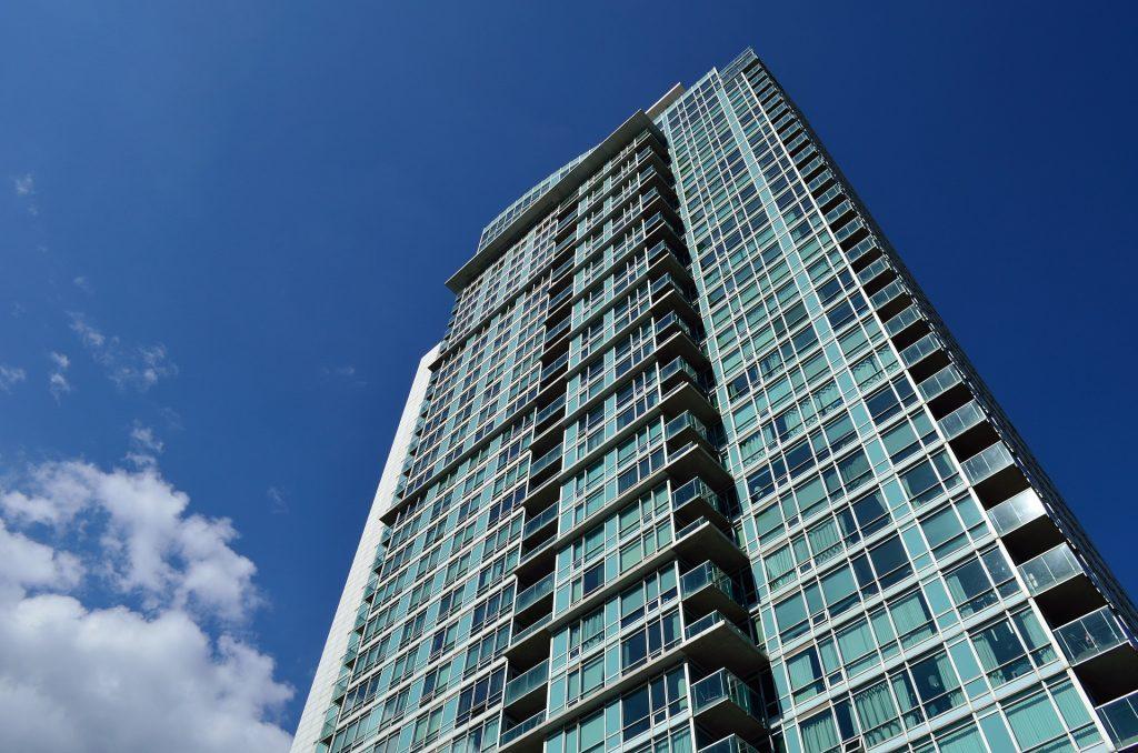 Trendy Markham condominium with blue-tinted glass windows
